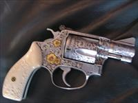Smith & Wesson model 60-1,fully super deep relief master hand engraved by Valenya,with 24k flowers etc.,really pricey engraved Ivory grips,stainless,38special,5 shot,one of a kind masterpiece-never seen nicer ever !!