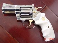 "Colt Diamondback,2 1/2""barrel,38 spl,1978,fully refinished in bright mirror nickel with 24K gold accents,bonded ivory grips,awesome showpiece !!"