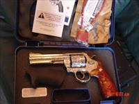 "Smith & Wesson 629-6 -fully engraved & polished by Flannery Engraving, 5"" barrel,custom Rosewood grips & originals,44 mag,in case with papers etc. a rare 1 of a kind work of art !!"