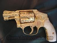 "Smith & Wesson Model 40,grip safety,Centennial,concealed hammer, no dash,24K plated,100% + master engraved by Flannery,38spl.,2"",5 shots,4 screws,aound 1955,Pearlite grips,awesome one of a kind masterpiece !!"