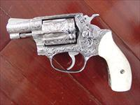 "Smith & Wesson model 60-7,fully engraved by Flannery,2"" barrel,Pearlite grips,38 spl,Chiefs Special,25 years old & a real showpiece !! awesome !!"