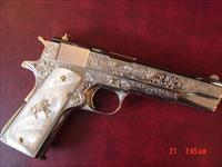 Colt Government Series 70 45acp, Master engraved by S.Leis & refinished in bright nickel with 24k gold accents, pearlite grips,& never fired-awesome showpiece- 1 of a kind !
