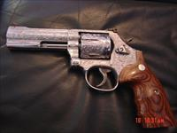 "Smith & Wesson 686-6,fully engraved & high polished by Flannery Engraving,custom grips & regular grips,4"" barrel,357 mag,serial numbered box,etc.,a real masterpiece,1 of a kind"