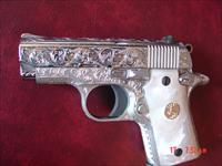 Colt Mustang Pocketlite 380,fully engraved & polished by Flannery Engraving,Pearlite grips,2 mags,certificate,box & manual.a true work of art !!