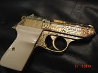 Walther PPK/S 1 of 500 limited collectors series,fully factory engraved,24K plated,leather fitted case 2 mags,bonded ivory grips & original black grips.380 auto,Interams model,rare showpiece