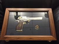 Desert Eagle from Magnum Research,rare 25th Anniversary model #114 of only 250 made,50AE hand cannon,Titanium Silver finish with 24K accents,silver coin & wood grips,in wood & glass case-awesome collector piece.