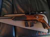 "Anschutz Exemplar 22LR, 10"" barrel, Leupold scope, 3-5 round magazines, bolt action,nice wood stock, light trigger,super accurate & very rare now !!"