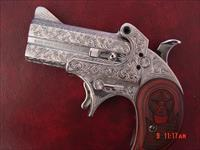 Bond Arms 410/45Colt,fully engraved & polished by Flannery Engraving,Cowboy Defender Derringer 2 shots,rosewood grips,certificate,box etc,never fired. awesome showpiece !!