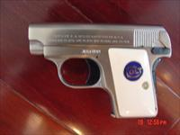 Colt 1908,25 cal.Vest pocket,hammerless,fully refinished in satin brushed nickel with blue accents,bonded ivory grips,,& made in 1915 !! looks better than new !!awesome pocket pistol !!