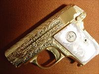 Colt 1908 Vest Pocket 25 auto,100% + Master engraved by Flannery engraving,24k plated,Pearlite grips,made in 1918, one of a kind work of art !!