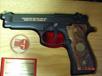 Beretta Model M9 92FS-Americas Defender 20th Anniversary commemorative to the armed forces,9mm,24k gold writing,made 2005,nice wood grips,15 round mag,5 medallions,very heavy fitted wood case
