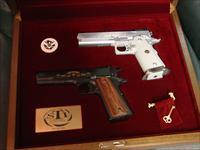 STI International,2 pistol set,100th Anniversary of the 1911,matching serial #s,45asp,one is the STI Legend specs,& the other is the 1911 GI specs,NIB,with all papers,& over $4000. retail price,awesome pair,#287 of only 500 ,wood pres case