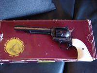 "Colt Kit Carson Commemorative,New Frontier,22LR,6"" barrel,#603 of 951 made in 1984,gold etchings,case hardened frame,faux ivory,original box & manual"