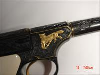 Colt Woodsman 1936 1st series,22lr,master engraved by Jim Sornberger,24k gold wire,deep relief engraving,24k fox with rabbit,ivory grips,& way nicer in person