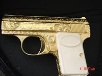Browning Baby 25 cal,fully engraved & 24K gold plated by Flannery Engraving,made in 1967,a tiny work of art,like jewelry ! awesome !!
