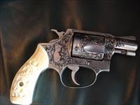 "Smith & Wesson 60,no dash signed by,Ben Shostle master engraved,nude lady,deep relief scroll,carved ivory grips,38 special,1 3/4""barrel, & one of a kind work of art"
