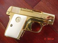 Colt 1908, 25 cal, Vest Pocket,hammerless,made 1918,just refinished in bright 24K gold plating,bonded ivory grips-awesome showpiece