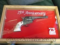 "Ruger New Vaquero,Ducks Unlimited 75th Anniversary,limited edition,45LC,5 1/2"",scrimshaw custom grips & regular grips,large engraved wood & glass pres case,original box & all papers,gold writing,never fired-awesome revolver."