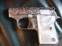 Astra Vest pocket 22 short caliber,fully factory scroll engraved,Pearlite grips,nickel plated,great concealed show pistol for pocket or purse !!