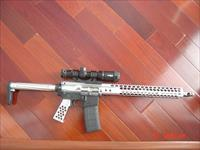 "Aero Precision X15 multi caliber,556 or 223,all aluminum,stainless or nickel, nice tri illuminated scope,16"",never fired,awesome showpiece !!"