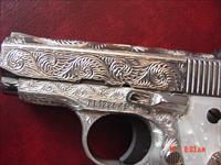 Colt Mustang Pocketlite 380,fully deep hand engraved & polished by Flannery Engraving,Pearlite grips,2 mags,box & papers,certificate,awesome showpiece
