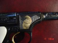 Colt Woodsman,engraved by Jim Sornberger,24K wire & inlays,6 1/2