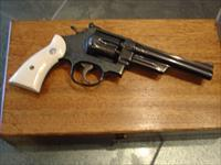 "Smith & Wesson 28-2,Highway Patrolman,custom engraved,high gloss blued,beautiful aged ivory grips,fitted wood pres.case,6"",357 magnum-awesome one of a kind !and around 1969"