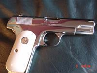 Colt 1908,380 auto,fully refinished in bright nickel,bonded ivory grips,hammerless,made in 1921,a super nice showpiece !!