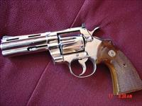 "Colt Python 4"",357 magnum,refinished nickel,wood grips, made in 1976,great shooter,just not show quality"