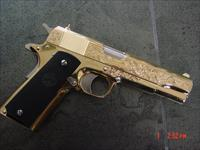 Colt Government 1911,38 Super,24K gold plated with nickel accents, master engraved by Seattle Engravers,2 mags,never fired,in case with manual etc.a real showpiece,-1 of a kind !!
