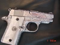 Colt Mustang Pocketlite,fully engraved by Flannery Engraving,polished slide,pearlite grips,2 mags,box & all papers,Cerakote frame-awesome work of art