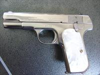 Colt 1908 380 auto,refinished nickel,94 years old,REAL pearl grips,and a 32 barrel with blue magazine,hammerless,grip safety circa 1921