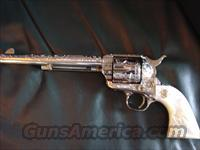 "Colt SAA 1961- 125th Anniversary,45 Colt,71/2"" nickel plated & master scroll engraved with gold accents,by Dwayne Woody,real MOP grips,a one of a kind work of art-53 years old !!"