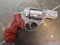 "Ruger SP101,2 1/4""barrel,master engraved by Ken Smith, 357 magnum,custom rosewood grips & originals ,a true work of art"