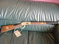 Winchester John Wayne Model 94,lever action,32/40 caliber,presentation grade wood,engraved receiver on both sides,box,papers,& made around 1981