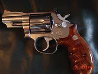 "Smith & Wesson model 66-3,circa 1985/86 polished stainless,snubby 2 1/2"" barrel,nice wood finger groove combat grips.its like a mirror.smooth light trigger-like new !!"