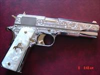 Colt Government 45,master engraved by S.Leis & refinished in bright nickel with 24K accents,Pearlite grips,never fired. a 1 of a kind work of art !!