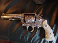 "Smith & Wesson model 10-6,fully engraved by Flannery engraving,refinished in bright polished nickel,pearlite grips,1968,4"" pinned barrel,38 S&W Special,a one of a kind work of art !!"