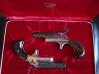 Colt Derringer matching pair,consecutive #'s,Lord models,22 short,wood grips,fitted colt case &  outer case,cleaning brush,minor wear