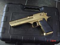 "Magnum Research Desert Eagle 44 Magnum,Titanium, fully high gloss gold in case with all papers & DVD etc.,6"" top accessory rail,never fired,brand new 44 showpiece!!hand cannon"