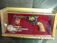 "Colt Frontier Scout 22LR,Missouri 150 year Sesquicentennial commemorative,4 3/4"",1970,gold plated & blued,stand up pres.case,manual,key,unfired in 43 years-very nice"