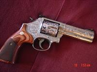 "Smith & Wesson 686-6,fully engraved & polished by Flannery Engraving,custom wood grips,4"" barrel,357 mag,in box with papers-awesome showpiece !!"