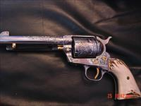 Colt SAA,master engraved by Clint Finley,nickel,2nd Gen,45LC,24K accents,3 Cherubs,1 of 600 W.Va commemorative,real stag grips & pricey original Colt grips,circa 1963- awesome one of a kind work of art-non fluted cylinder !!