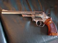 "Smith & Wesson model 29-2, 8 3/8"" barrel, bright high polished mirror nickel,44 magnum,wood grips, & nice Bianchi leather holster,a real showpiece"