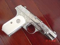 Colt 1903 32 caliber,made in 1914 !! master engraved by S.Leis,& refinished in mirror nickel,certificate,& bonded ivory grips-one of a kind showpiece