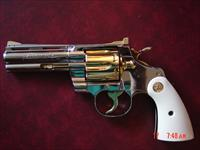 "Colt Python 4"" 1960, just refinished in bright mirror nickel with 24K gold accents, & bonded ivory grips, awesome showpiece thats 58 years old now !!"