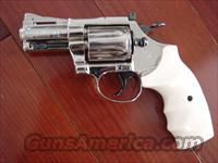"Colt Diamondback 2 1/2"",refinished nickel,blue accents,bonded ivory fingergroove grips,38 special,made in 1975,nicer than new"