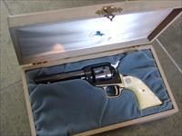 "Colt Frontier Scout Nevada Statehood Centennial Comemmorative,22LR,4 3/4"" barrel,made in 1964,nickel plated & blued,1864-1964 stamped,nice Pearlite grips,wood presentation case & unfired !! a beauty !!"