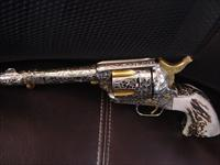 "Colt SAA 2nd gen,1971,polished nickel,fully 100% deep master hand engraved by Robert Valade of Oregon,NRA 100 year centennial,rare Sambar Stag grips,357 magnum,5 1/2"" barrel & heavy  24K gold accents,a rare one of a kind masterpiece"