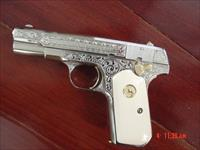 Colt 1903 32ACP,1923,Master engraved & refinished nickel,by S.Leis,bonded ivory,24K gold accents,certificate,awesome showpiece